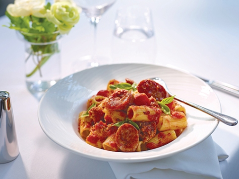 Rigatoni with Tuscan sausage in spicy tomato sauce, sprinkled with Parmesan